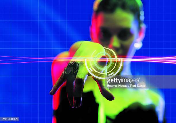 young woman pointing to digitally designed concentric circles - gel effect lighting stock photos and pictures