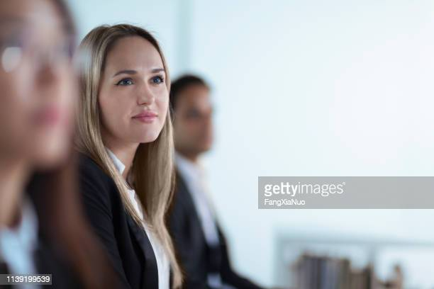 young woman portrait at meeting in office - incidental people stock pictures, royalty-free photos & images