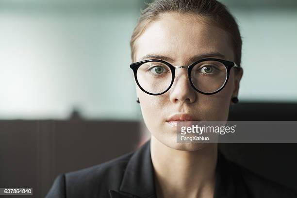 young woman portrait in business office - staring stock photos and pictures