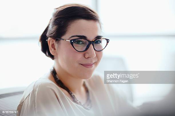 Young woman portrait in office meeting
