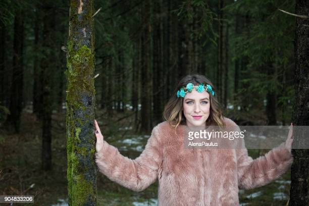 Young woman portrait outdoors in the forest