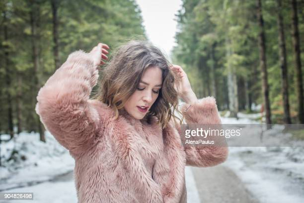 young woman portrait outdoors in the woods - pink coat stock pictures, royalty-free photos & images