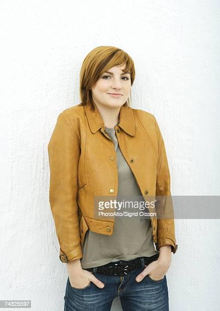 young woman, portrait - hands in pockets stock pictures, royalty-free photos & images