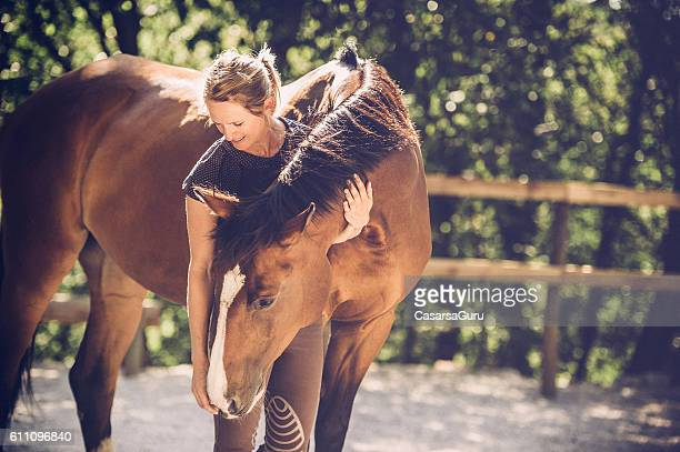 young woman portrait with her horse - horse stock pictures, royalty-free photos & images