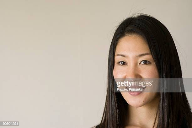 young woman portrait,smiling - kazuko kimizuka stock-fotos und bilder