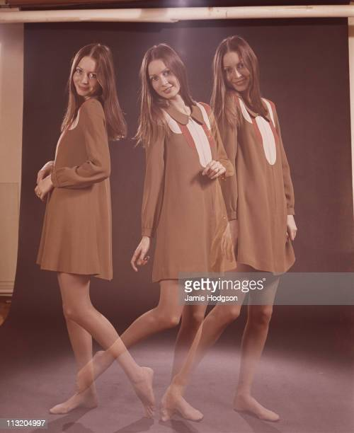 A young woman poses in a brown minidress circa 1970