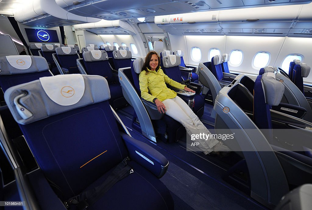 A young woman poses in a business class seat of the new airplane Airbus A380 of the German airline Lufthansa after the test landing at the Franz-Josef-Strauss airport in Munich on June 2, 2010. The A380 currently tours German airports practicing landing and take-off.