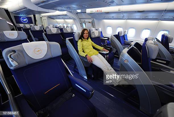 A young woman poses in a business class seat of the new airplane Airbus A380 of the German airline Lufthansa after the test landing at the...