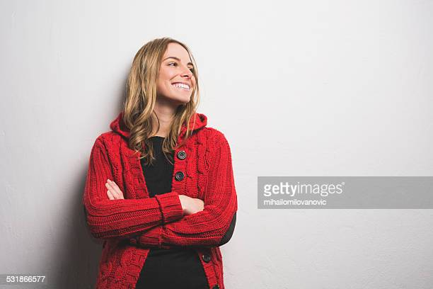 young woman posing against the wall - sweater stock pictures, royalty-free photos & images