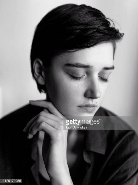young woman posing against white wall - androgynous stock pictures, royalty-free photos & images