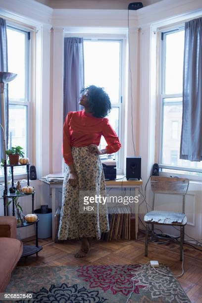 A young woman posing by windows