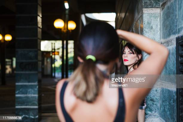 young woman posing for a photo shoot - photo shoot stock pictures, royalty-free photos & images