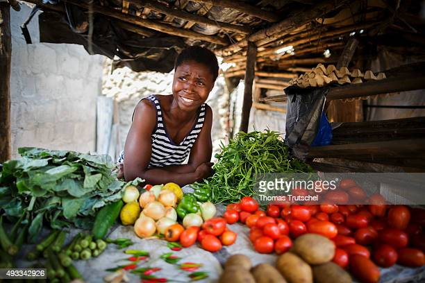 A young woman posing for a photograph at her Vegetables Stand in a slum in the city of Beira on September 28 2015 in Beira Mozambique