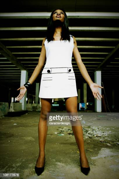 Young Woman Posing in Abandoned, Grunge Parking Garage