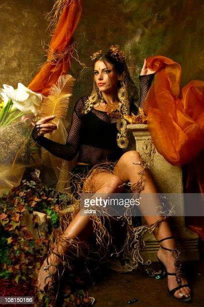 young woman posing in autumn decorative scene - gold shoe stock pictures, royalty-free photos & images