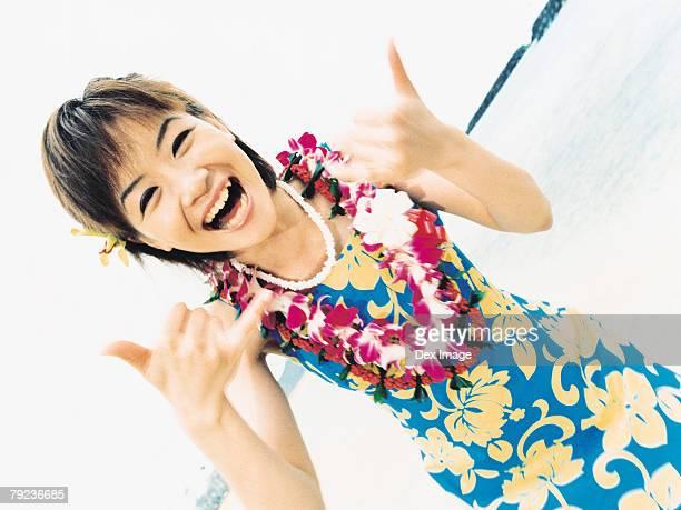 Young woman posing in Hawaiian blouse and garland