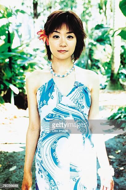 Young woman posing in Hawaiian blouse