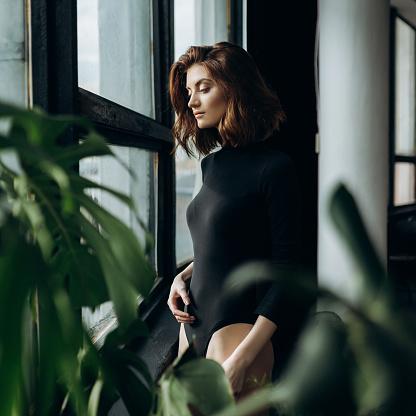 Young woman posing in studio - gettyimageskorea