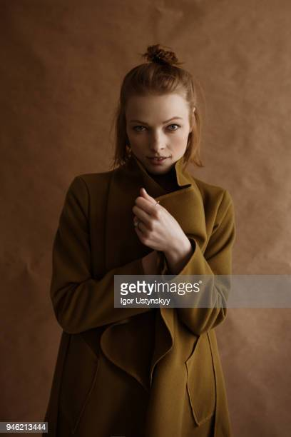 young woman posing in studio - coat fotografías e imágenes de stock