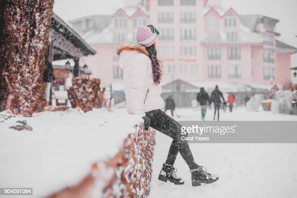 young woman  posing in the snow