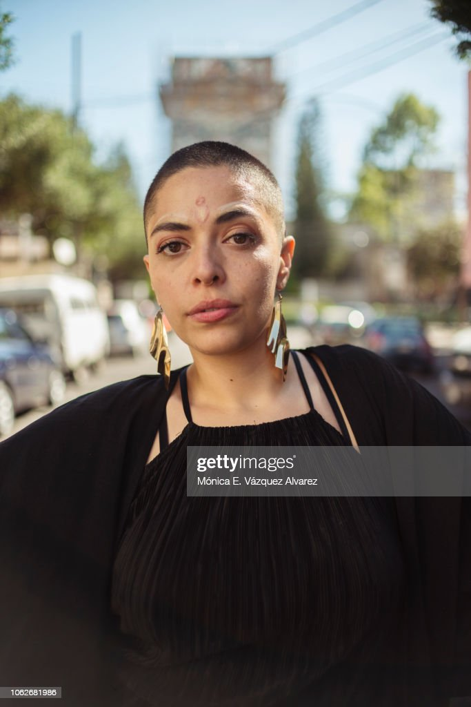 Young woman posing in the street : Stock Photo