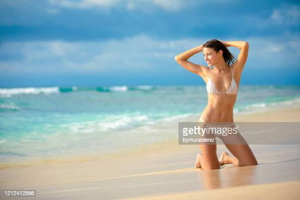 young woman posing on the beach - hot model indonesia stock pictures, royalty-free photos & images