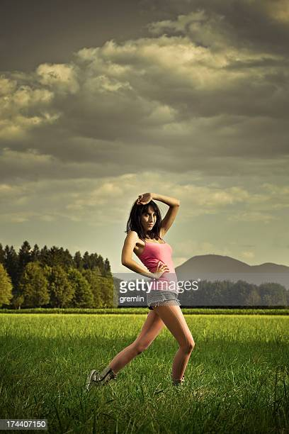 young woman posing on the field - teen pantyhose stock photos and pictures