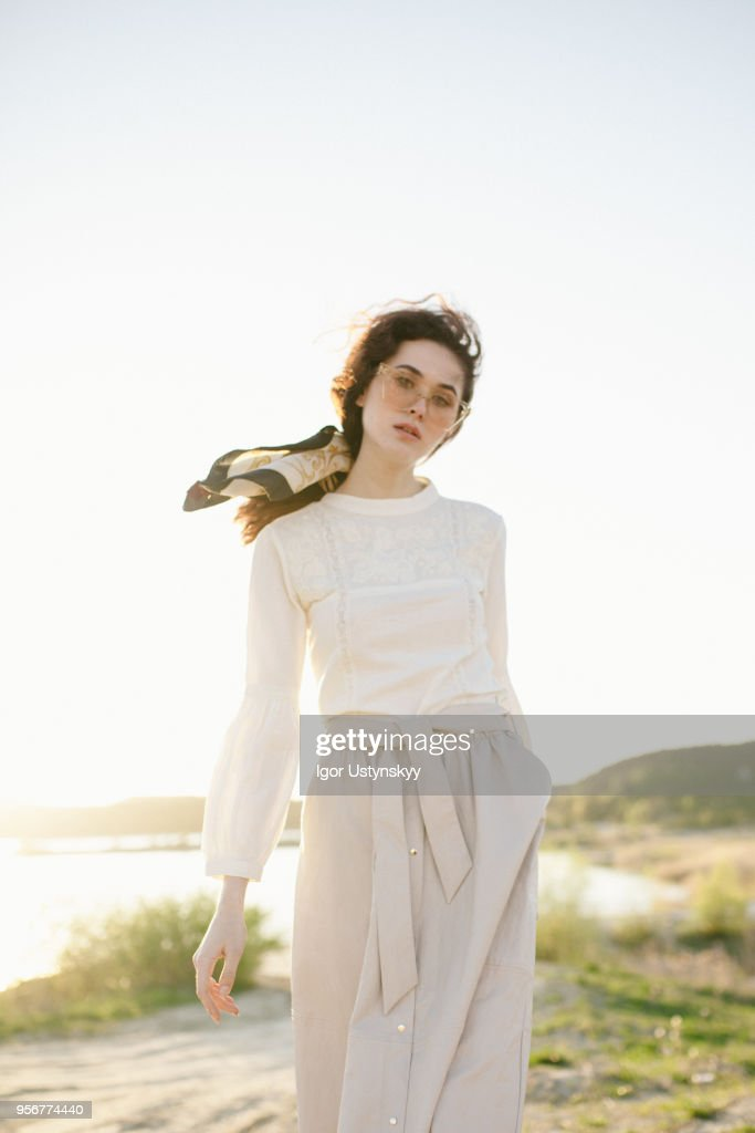 Young woman posing outdoors : Stock Photo