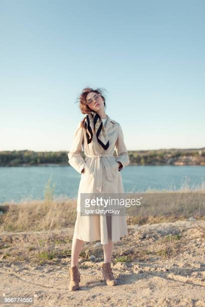 young woman posing outdoors - coat ストックフォトと画像