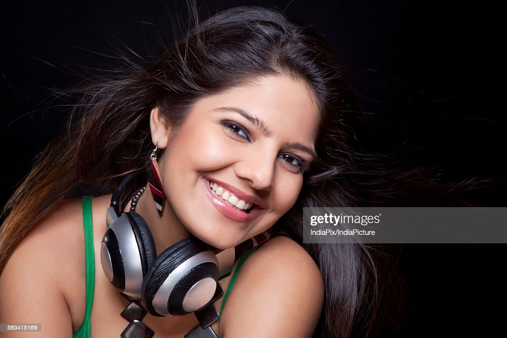 Young woman posing with headphones : Stock Photo