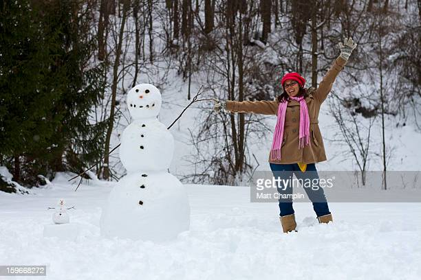 Young Woman Posing with Two Snowmen