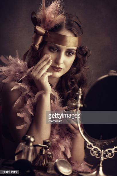 Young woman powdering face