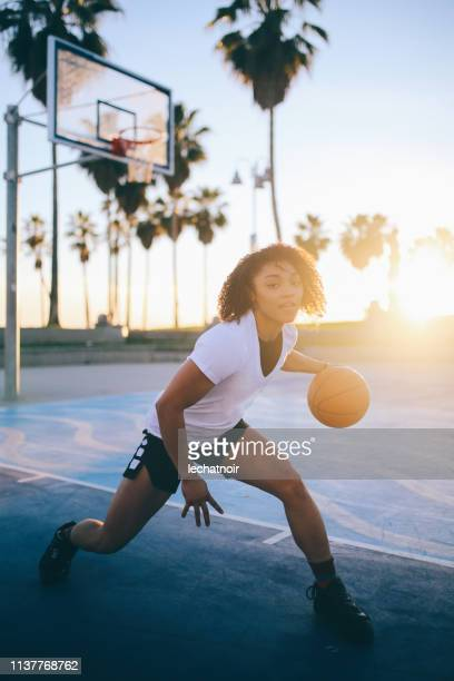 Young woman practice basketball dribble in Venice, California