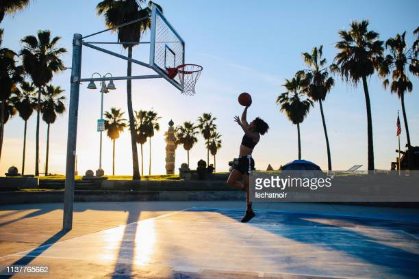 young woman practice basketball in venice, california - venice beach stock pictures, royalty-free photos & images