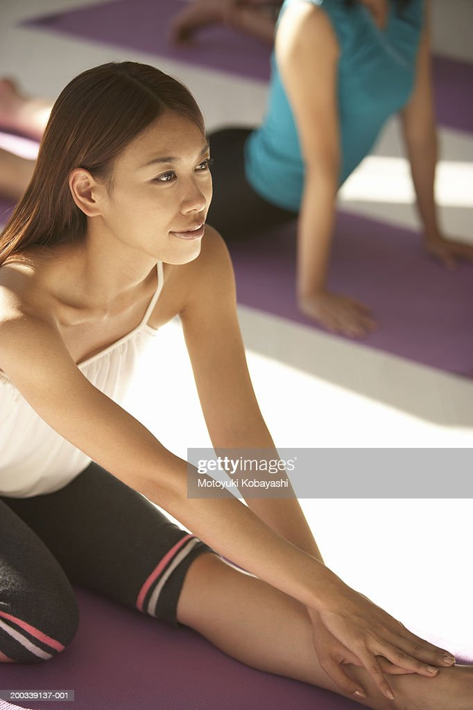 Young woman practicing oblique face one leg pose, elevated view : Stock Photo