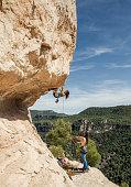 Young woman practicing rock climbing