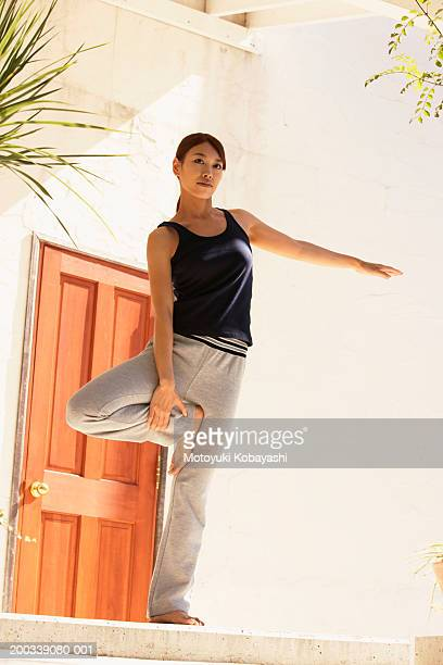 young woman practicing tree pose, ground view - standing on one leg stock pictures, royalty-free photos & images