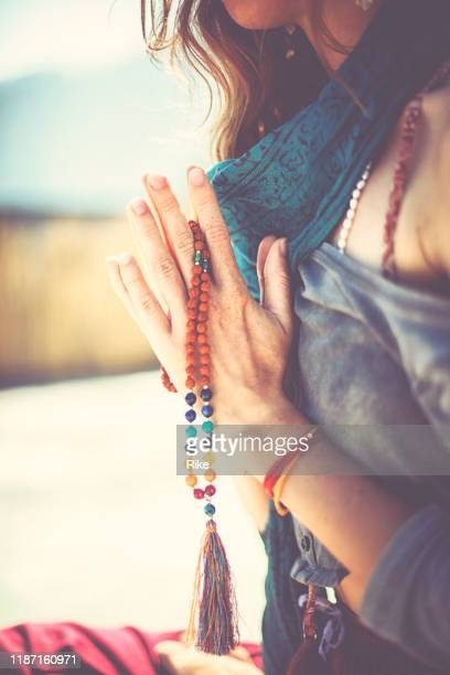 young woman practicing yoga and meditation in sunshine of india - spirituality stock pictures, royalty-free photos & images