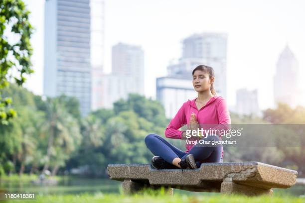 young woman practicing yoga in the city park, stock photo. - タイ人 ストックフォトと画像