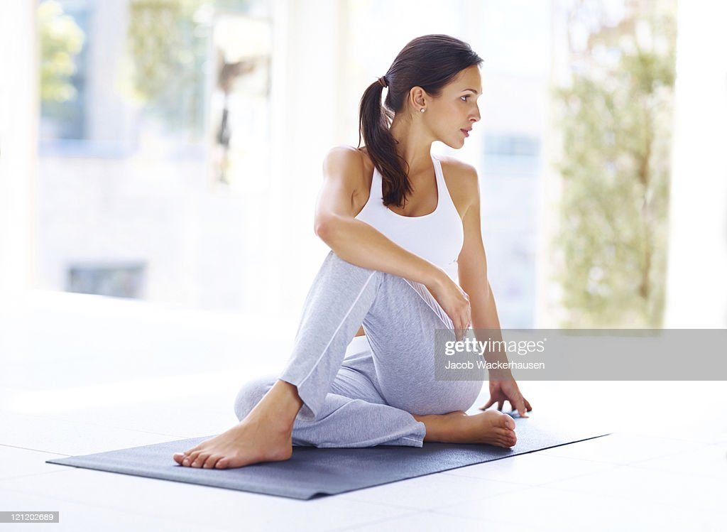 Young woman practising yoga exercise : Stock Photo