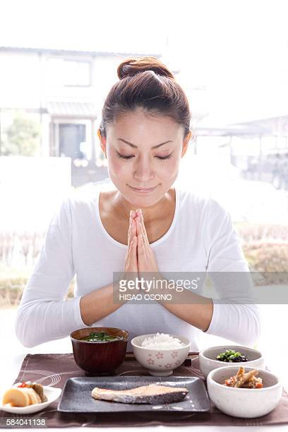 Young Woman Praying for Breakfast