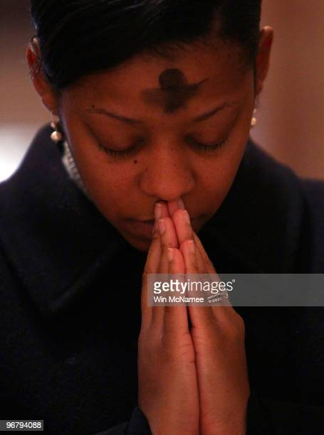 A young woman prays during an Ash Wednesday Mass at the Cathedral of Saint Matthew the Apostle February 17 2010 in Washington DC Today marks the...