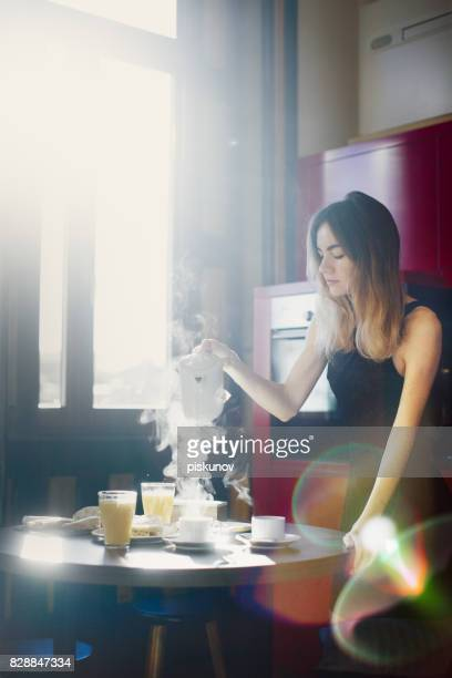 Young woman prepares breakfast