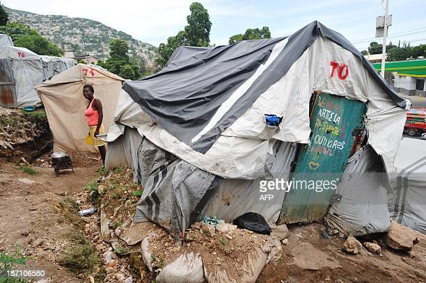A young woman prepares food on November 1 2013 at camp Acra in Pétionville Haiti where victims of the January 2010 eartquake are living in makeshift...