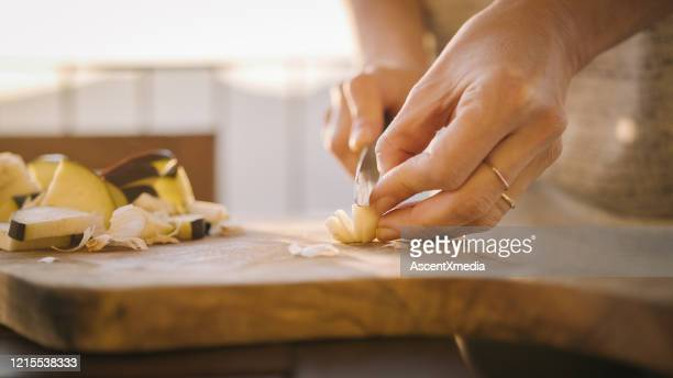 young woman prepares healthy meal on terrace - garlic stock pictures, royalty-free photos & images