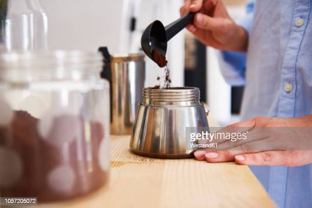 young woman preparing coffee in the morning - ground coffee - fotografias e filmes do acervo