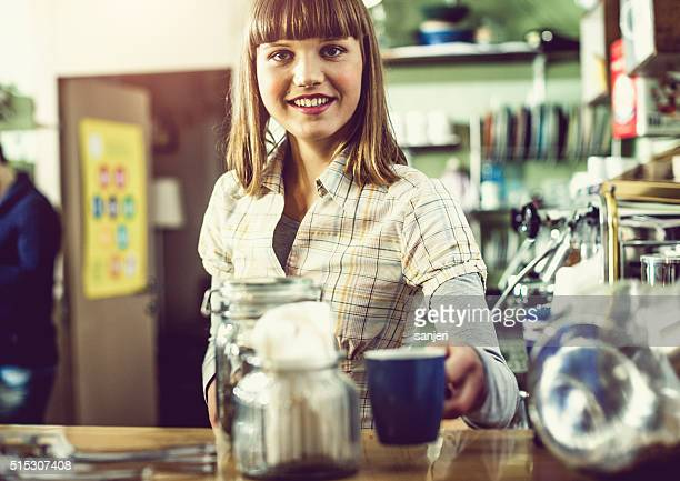 Young woman preparing coffee