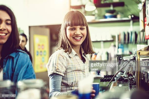 Young woman preparing coffee