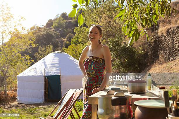 Young woman preparing food whilst glamping, Sierra Nevada, Andalucia Granada, Spain