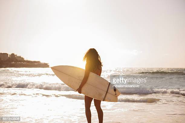 Young woman preparing for a surf